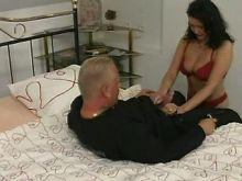 Hot brunette lady sucks cock on bed