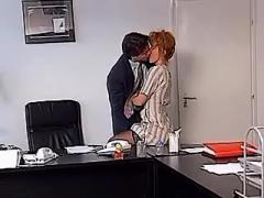 Lewd redhead office slut sucks cock