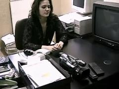 Sexual secretary sucking cock on camera in office