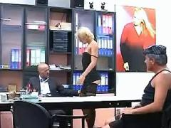 Hot blonde secretary in stockings sucks two cocks