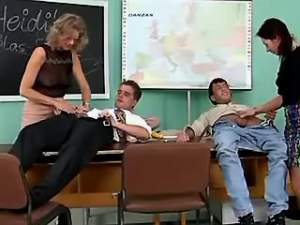 Three teachers in stockings serve her colleagues