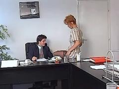 Redhead office slut greedily sucks cock after work