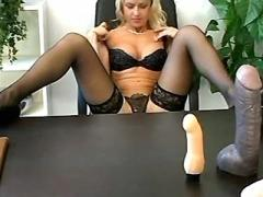 Sexy secretary plays with cock on desk after work